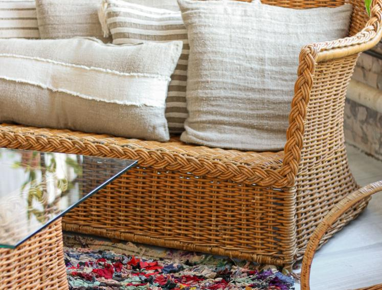 Rattan garden furniture with cream cushions