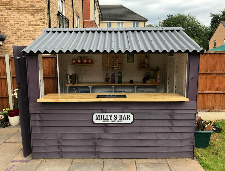 Purple garden shed turned into a bar with ONDULINE CLASSIC grey roofing
