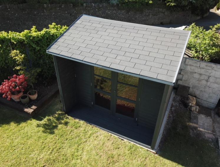 Grey BARDOLINE roof shingles on grey shed in garden
