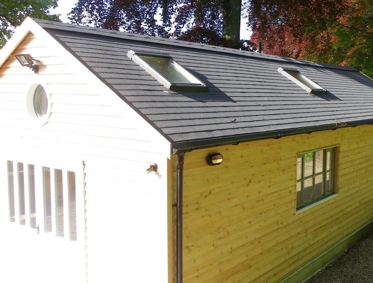 Light timber workshop shed with grey BARDOLINE roof shingles