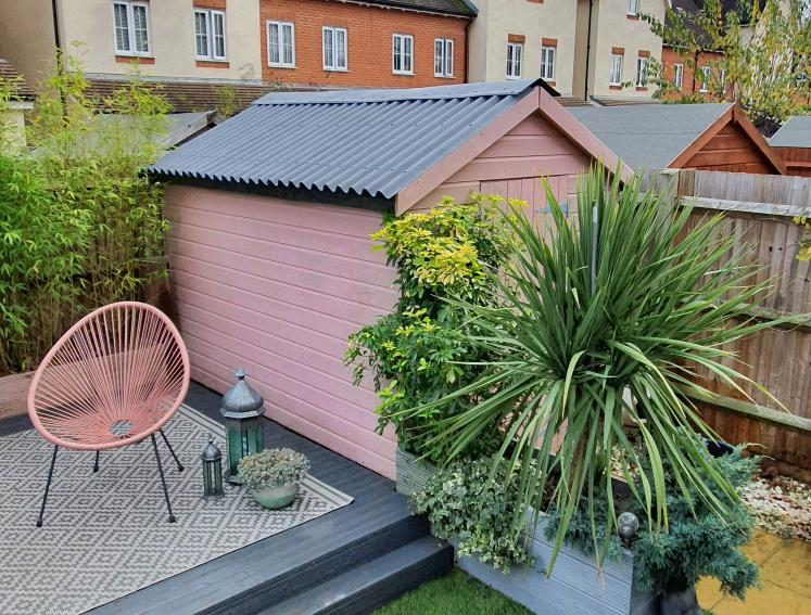 Pastel pink shed with grey ONDULINE CLASSIC roofing sheets