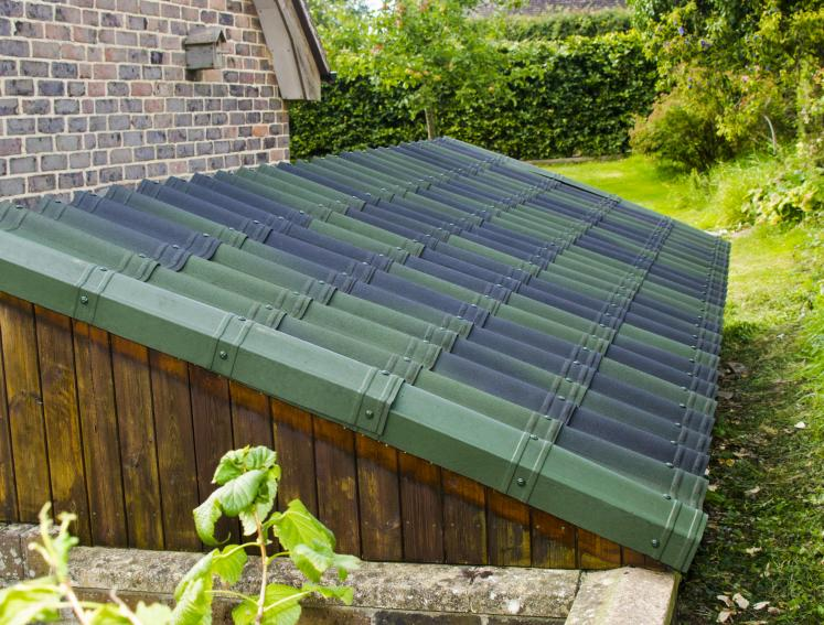 Green ONDUVILLA roofing sheets on lean to shed