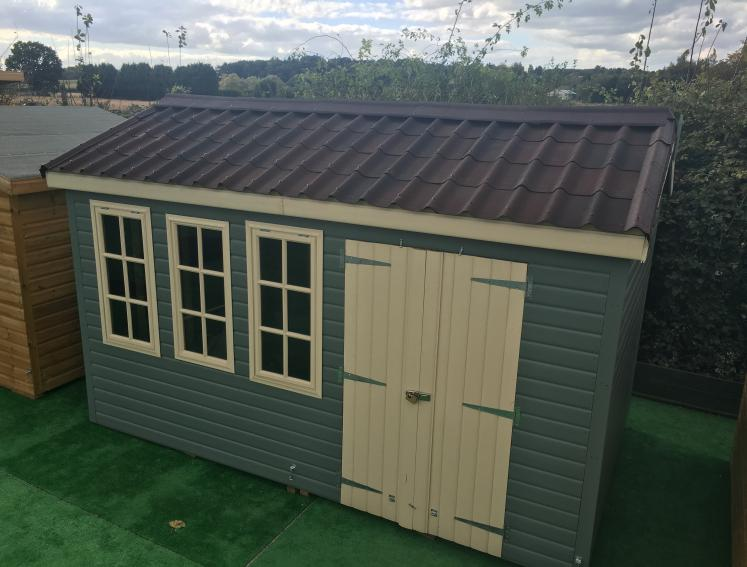 Green and white shed with ONDUVILLA tile look roofing sheets