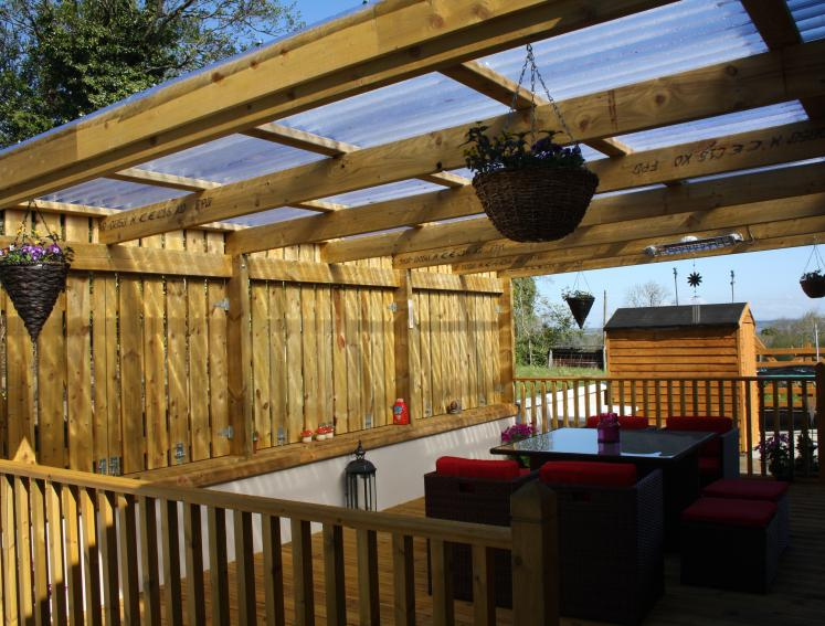 Outdoor dining area made from Onduline clear roofing sheets