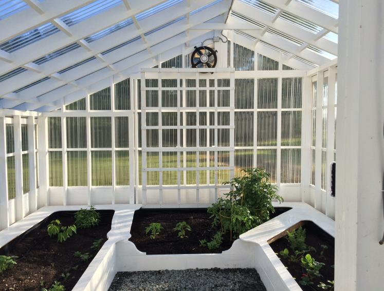 White timber greenhouse with Onduline ONDUCLAIR PC roofing sheets